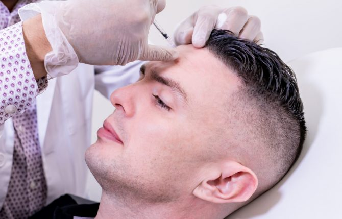 man getting face cleaned